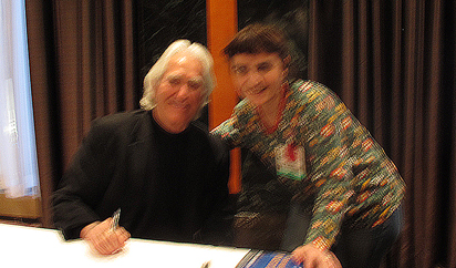 Dr. Larry Dossey and me after autographing his book